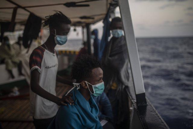Des migrants secourus en mer Méditerranée, à bord du navire de sauvetage de l'ONG Open Arms, le 9 septembre 2020.