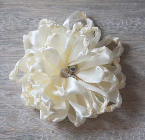 A Fabric Flower with crystal bead embellishments made using the Knotted Chrysanthemum How To Tutorial