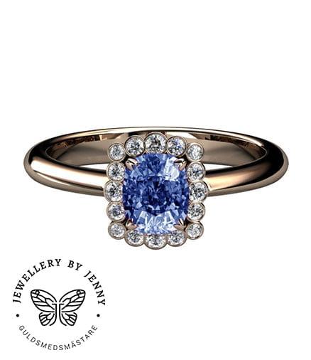 ring med diamanter och blå safir