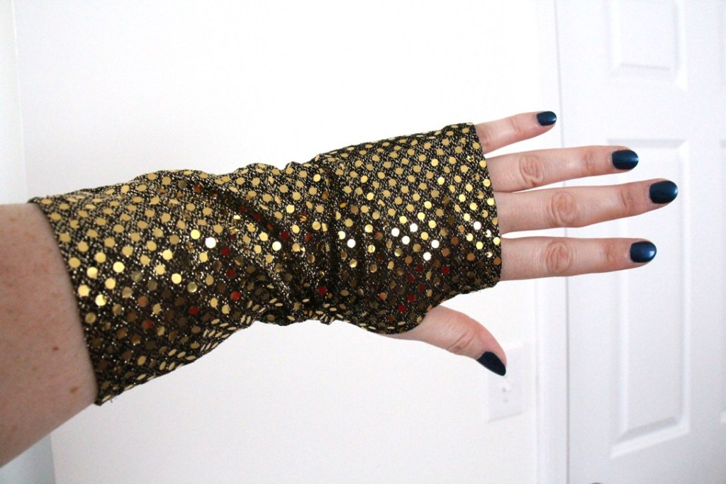 The back of my black and gold sequined fingerless glove.