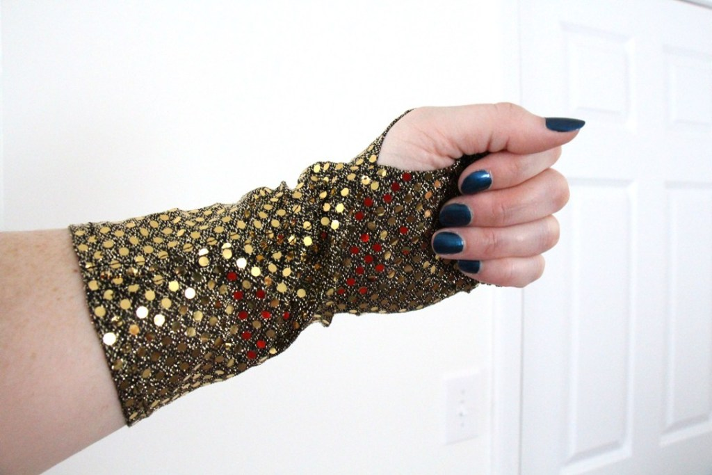 The palm of my black and gold sequined fingerless glove.