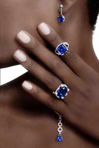 Tanzanite ring and erarrings jewelry on a black woman