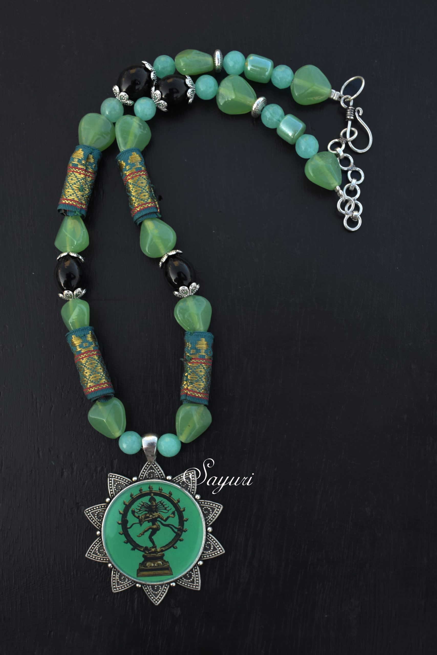 NP1217-DG Glass and agate bead necklace with Natraja pendant ₹ 850