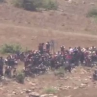 Watch: Hundreds of Syrians Approach Israel's Border