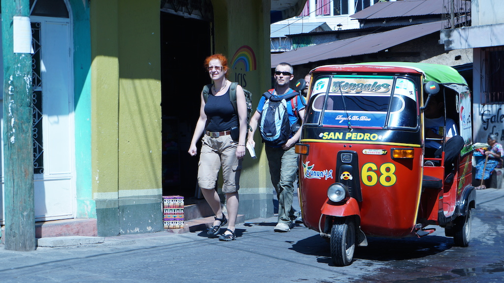 Tuk-tuks and tourists - a typical sight in San Pedro...