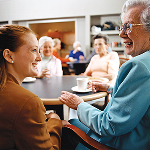 young woman visiting senior woman