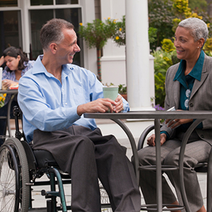 person with disabilities having coffee with a friend
