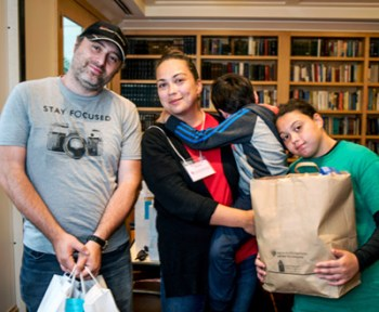Family with Rosh Hashanah Bags