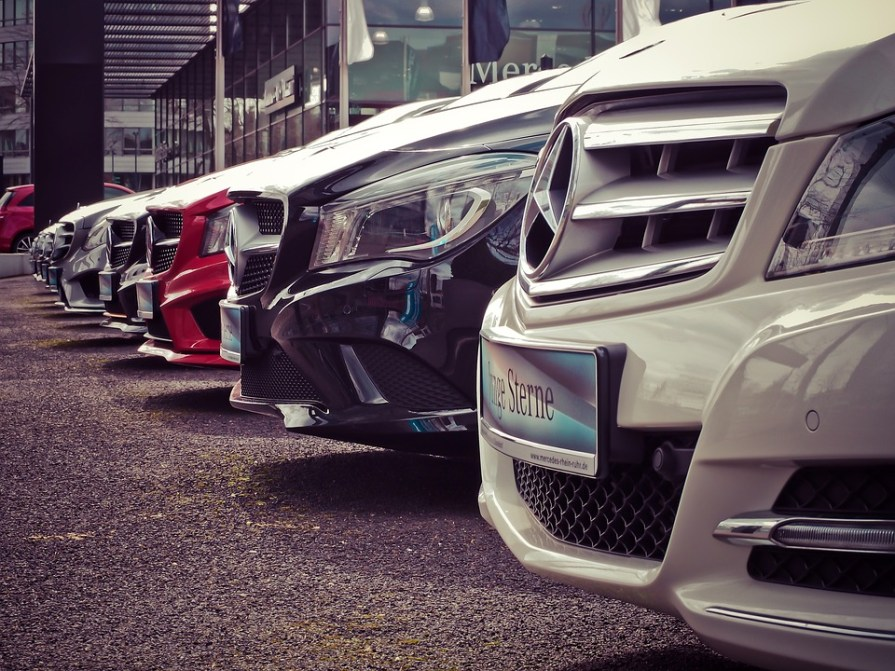 Front bumper of several cars parked