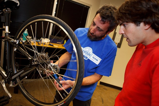Mechanic teaching at Bicycle Sport Shop
