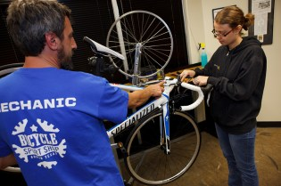 Mechanic teaching at Bicycle Sport Shop