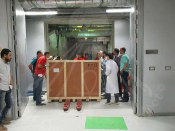 Transportation team moving the wall-paintings to GEM-CC's Lab