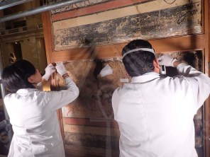 The conservators inspect the mural paintings