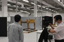 Japanese High resolution team taking High resolution Photo to Tutankhamen ritual bed