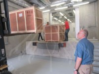 Loading the bed and chariot into the Conservation Center Preparation Room
