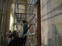 Egyptian experts of the mural painting team assembling scaffolds at the EM