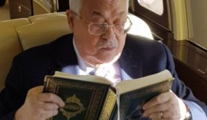 Fatah publishes photo of Abbas reading Qur'an on $50 million private jet while his people supposedly starve
