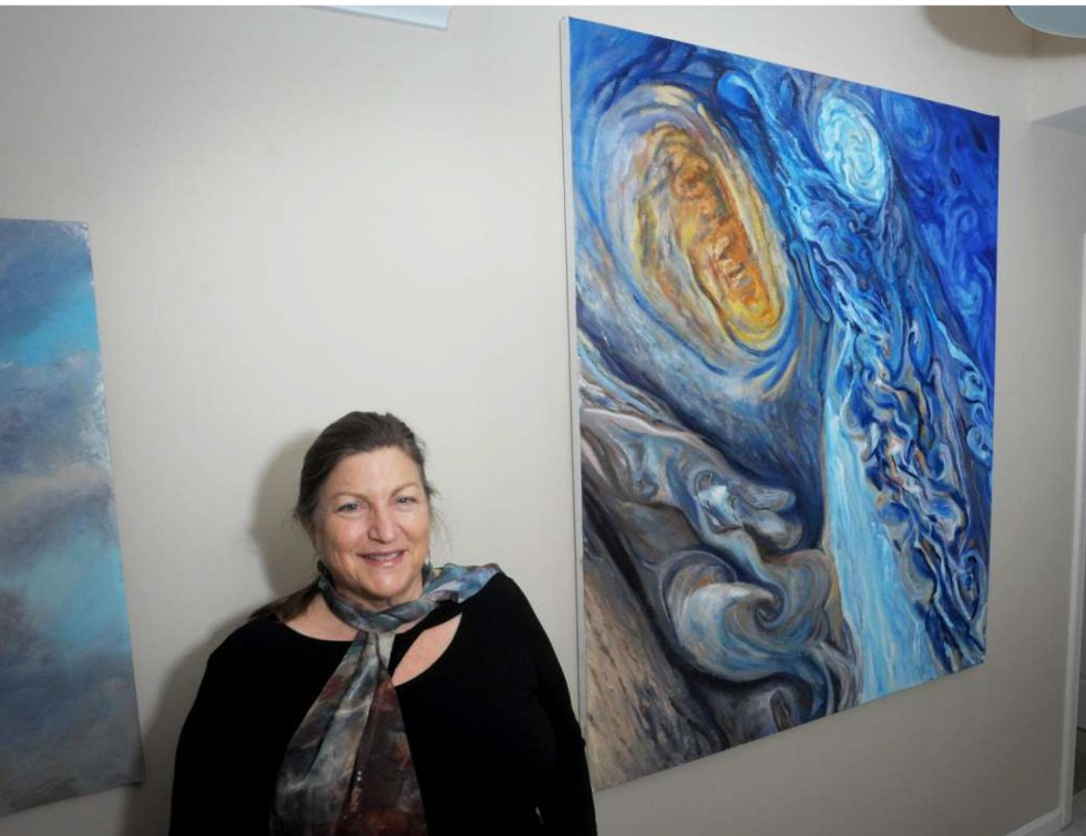 Jill Nichols poses in front of her painting 'Juno' in her home and studio in Shelton, Conn. Jan. 22, 2021 for Hearst Publications