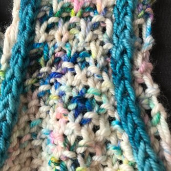 Tangiers in It Could Be Worsted in two colors. Transition from seed stitch to moss stitch
