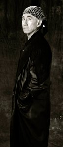 Standing, profile, long leather coat