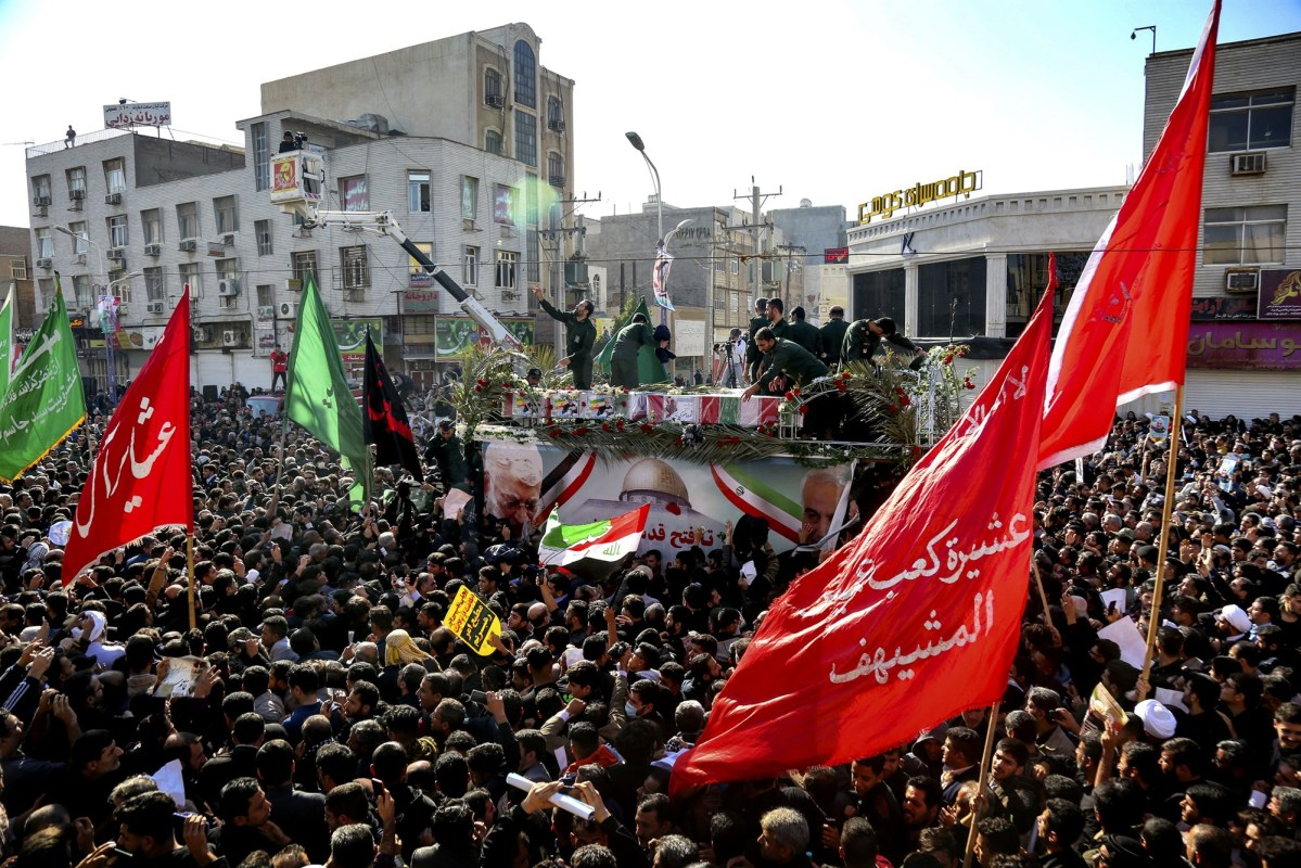 The flag-draped coffins of Iranian General Qassem Soleimani and other military officials drive through the streets as mourners pay their respects in Ahvaz, Iran, on Jan. 5, 2020.Alireza Mohammadi / ISNA via AP