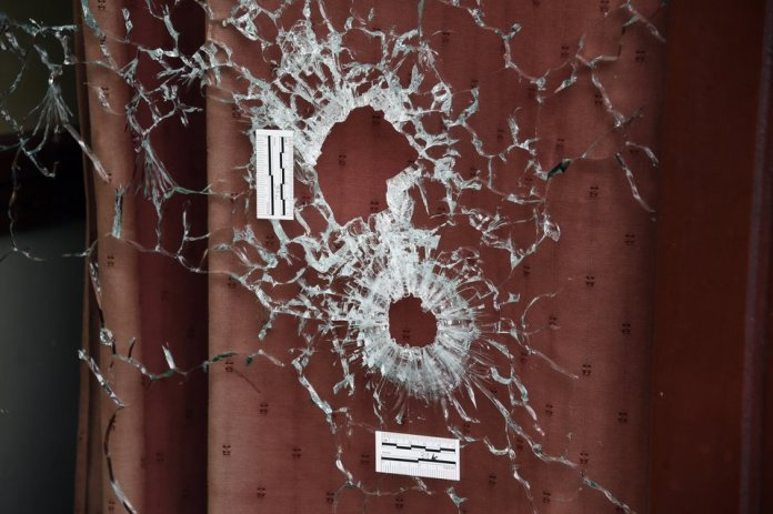 DOMINIQUE FAGET/GETTY IMAGES Bullet holes scar the windows of the Carillon and the adjacent Cambodian restaurant on Rue Alibert in the 10th district of the French capital Paris, on Nov.14, 2015, the morning after an attack that killed 12 people at the restaurant.