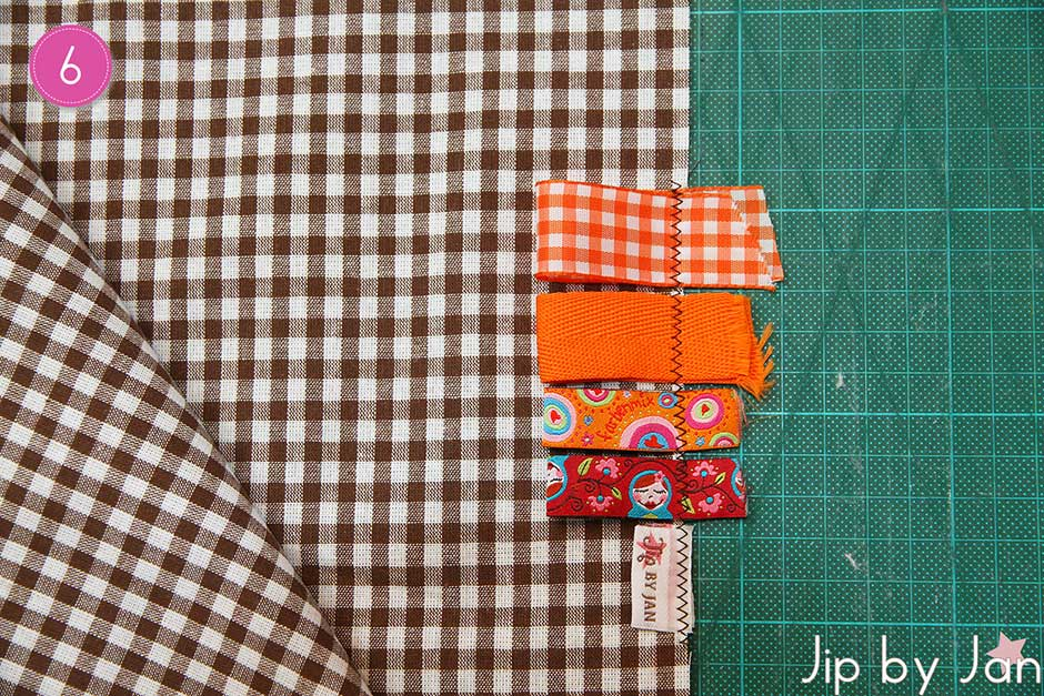 Step 4: For sturdiness you can fold the flaps down and glue them to the bottom of your bag. Or you can trim them. Your inner bag is done now.