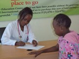 One of our primary school students shares information with one of the doctors.