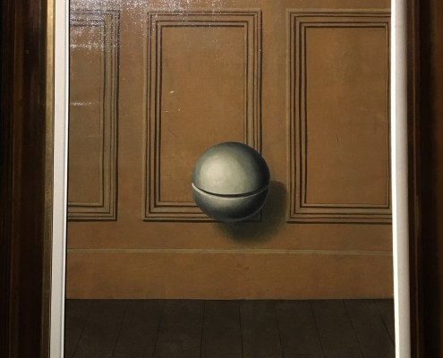 Floating orb in front of wooden panelling.