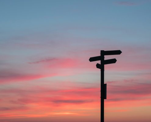 sunset and signposts