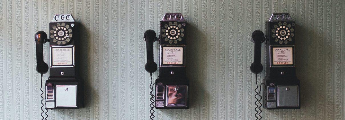 3 vintage telephone on the wall Photo by Pavan Trikutam on Unsplash