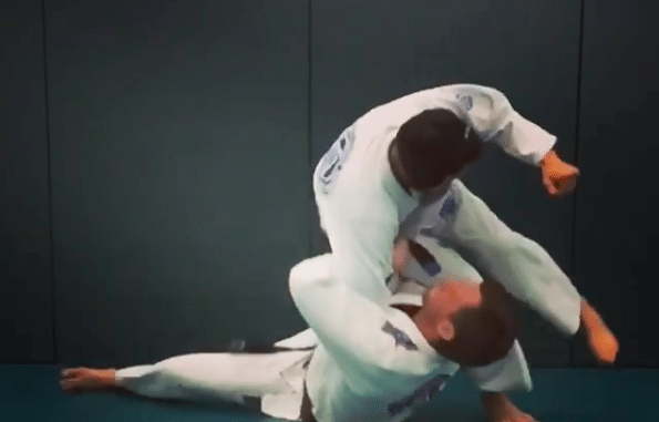 Takedown from a Russian Arm Tie Also Known As Zangief Roll