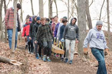 Members of the John Jay Track & Field team hauling one of the four 800 lb beams down the trail to bridge #1 to the site of bridge #2