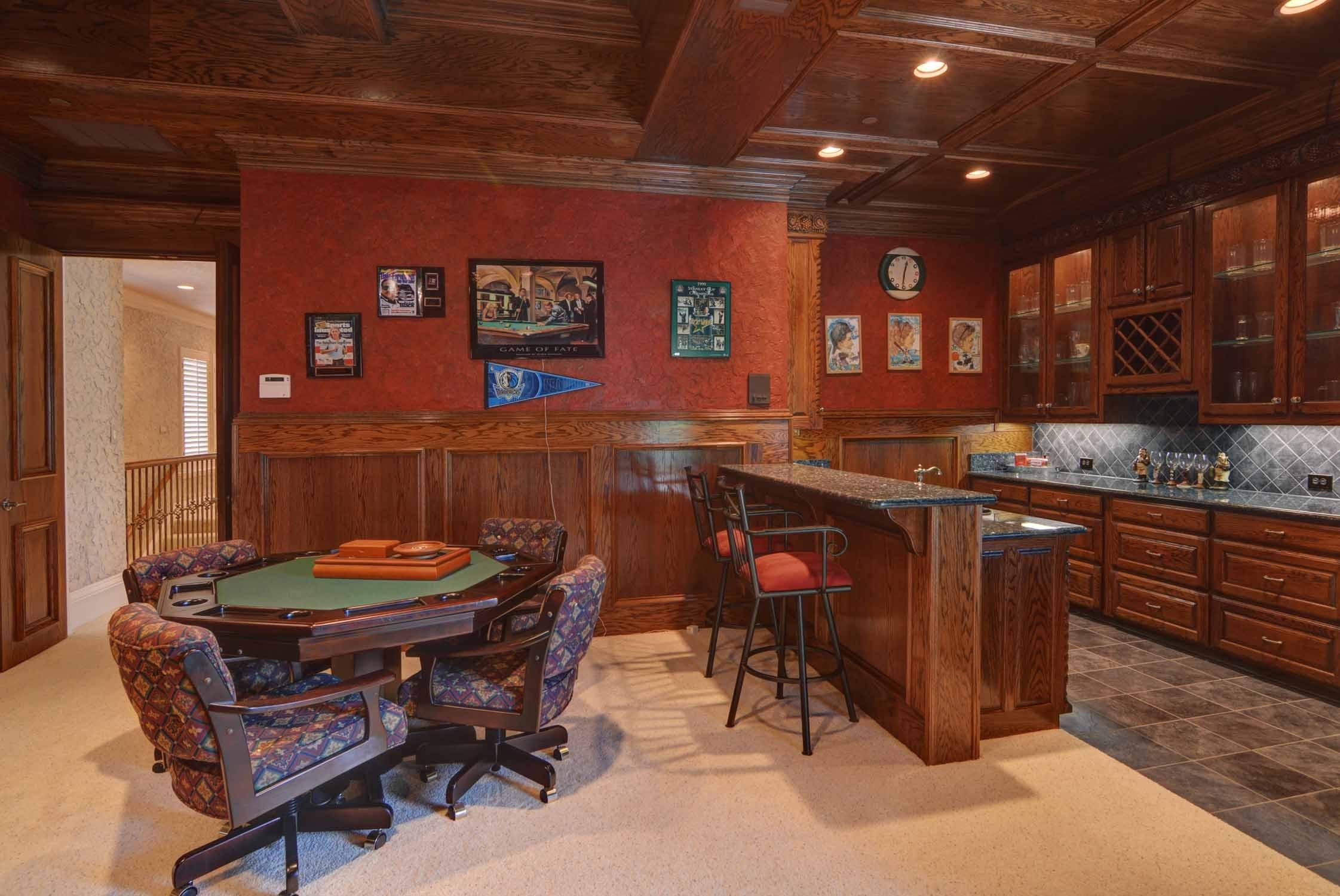 Dreaming of a man cave, home recording studio, bar, game room, or home theater? Game Room Bar - J. Lambert Custom Homes
