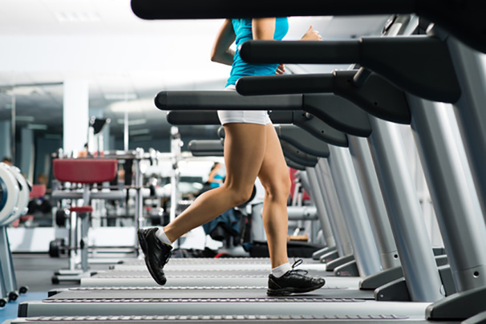 woman running on a treadmill workout