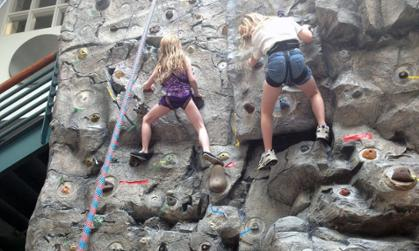 Two Campers Climb Rock Wall