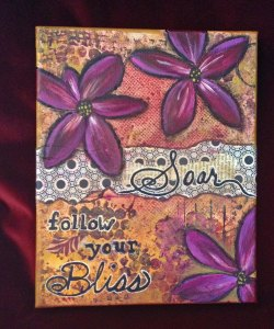"a photo of a collage with the prime focus word ""Soar"" and ""Follow your Bliss"""