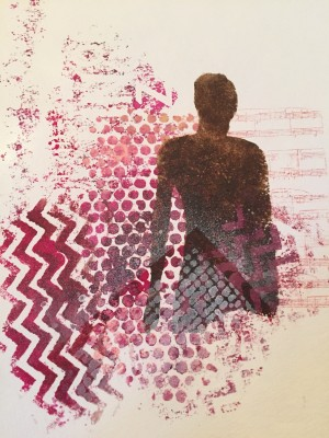 an art journal page created with a woman's silhouette and a variety of paint prints around it in burgundy