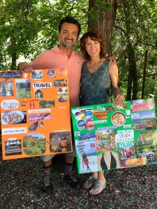 A photo of James and Joan holding their vision boards