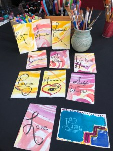 A photo of affirmation cards I created with water color paint and cold pressed paper