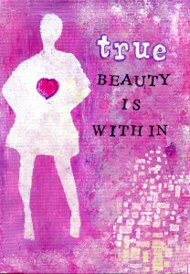 A canvas board with a pink background and a silhouette of a woman and the phrase: True beauty is within