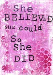 A canvas board in shades of pink with the stamped statement: She believed she could so she did