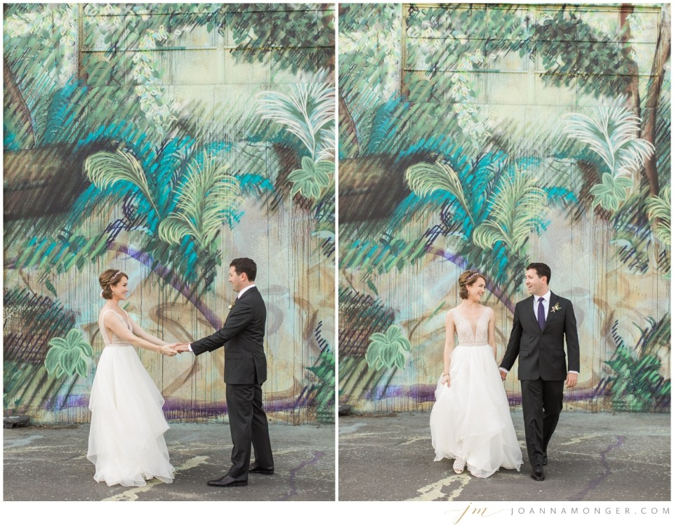 A bride and groom pose in front of a colorful mural during their elegant wedding at Canvas Event Space in SODO, Seattle, WA. | Joanna Monger Photography | Snohomish & Seattle Wedding Photographer