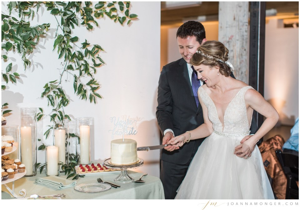 A bride and groom cut their cake during an elegant wedding at Canvas Event Space in SODO, Seattle, WA. | Joanna Monger Photography | Snohomish & Seattle Wedding Photographer