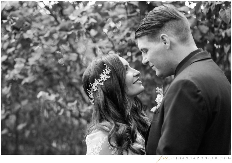 A bride and groom gaze lovingly at each other during a wedding at the Corson Building in SODO, Seattle, WA.   Joanna Monger Photography   Snohomish & Seattle Wedding Photographer