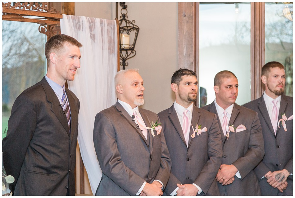 A groom's expression is captured as he sees his bride walking down the aisle of their special winter wedding at Hidden Meadows, a wedding venue in Snohomish near Seattle, WA. | Joanna Monger Photography | Snohomish & Seattle Wedding Photography