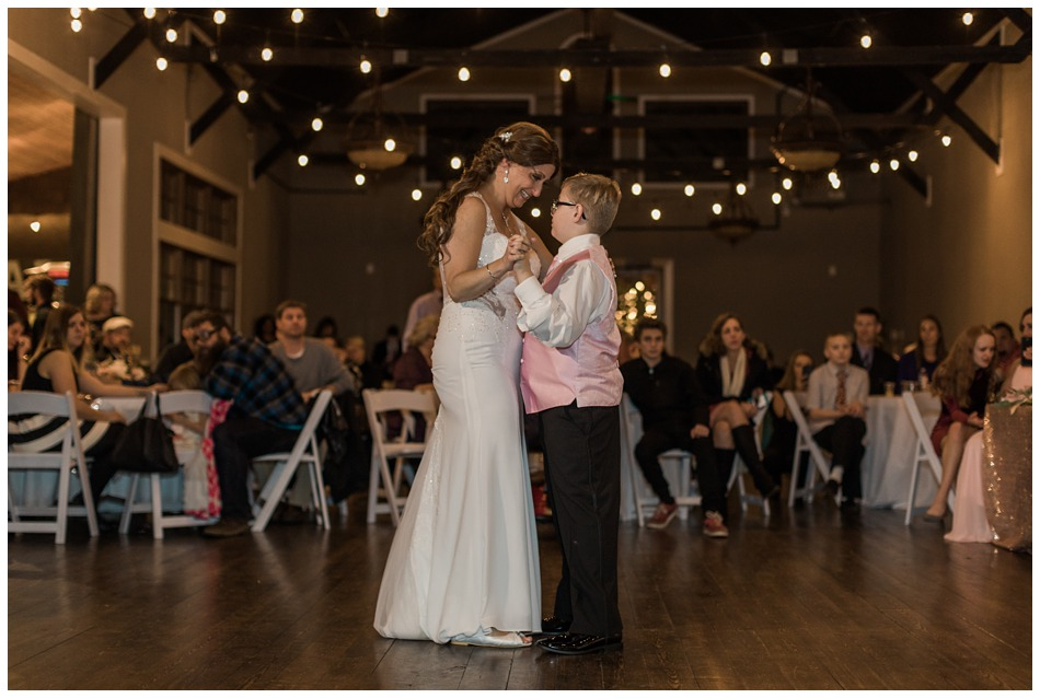 A bride dances with her son during the reception of her special winter wedding at Hidden Meadows, a wedding venue in Snohomish near Seattle, WA. | Joanna Monger Photography | Snohomish & Seattle Wedding Photography