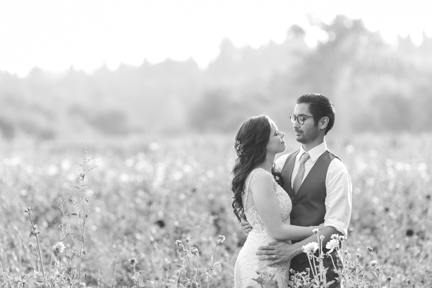 A black-and-white photo of a bride and groom gazing at each other before their wedding at Woodland Meadow Farms in Snohomish, a wedding venue near Seattle, WA. | Joanna Monger Photography | Seattle & Snohomish Photographer