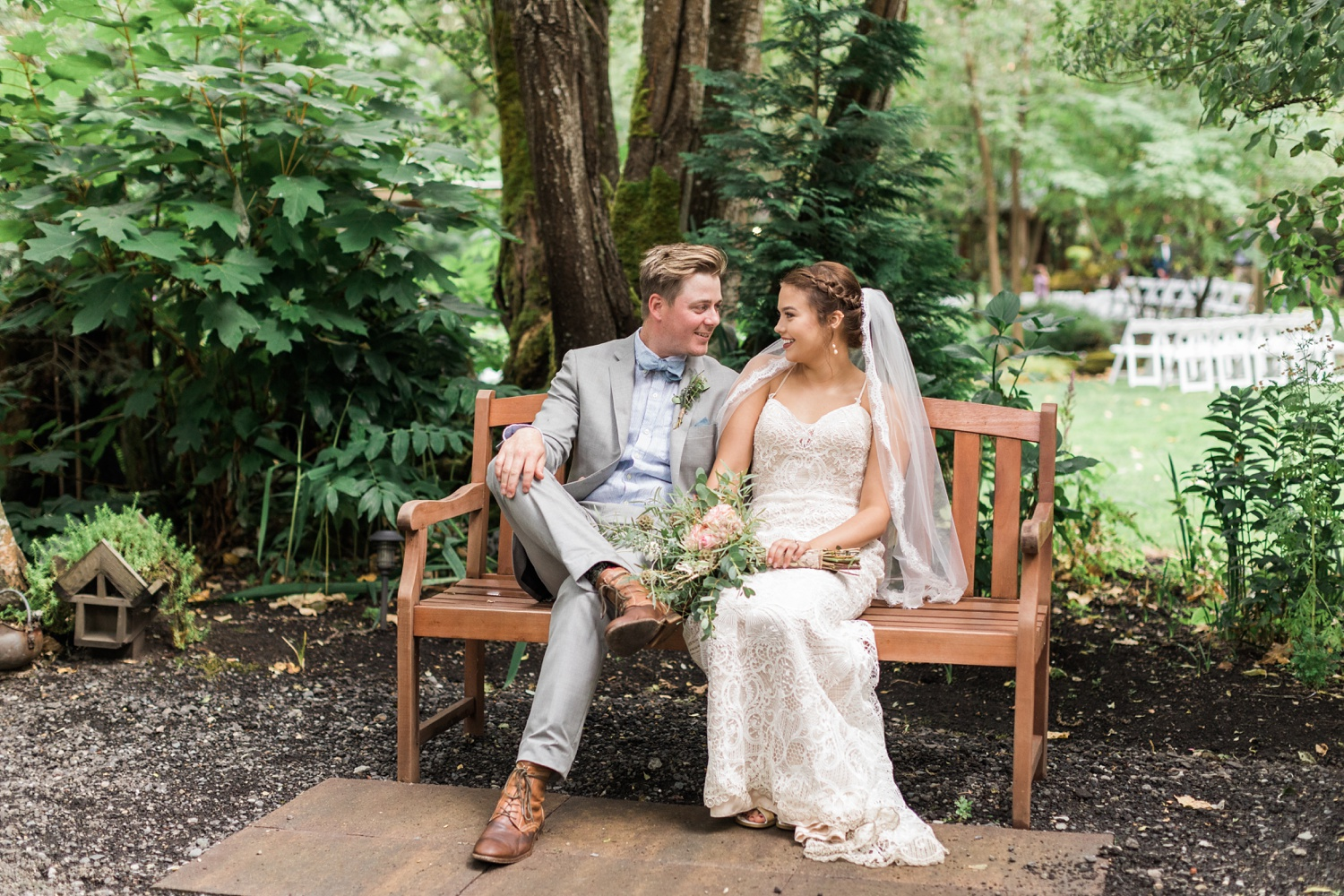 A bride and groom sit on a bench before their summer wedding at Maroni Meadows in Snohomish, a wedding venue near Seattle, WA. | Joanna Monger Photography | Seattle & Snohomish Photographer
