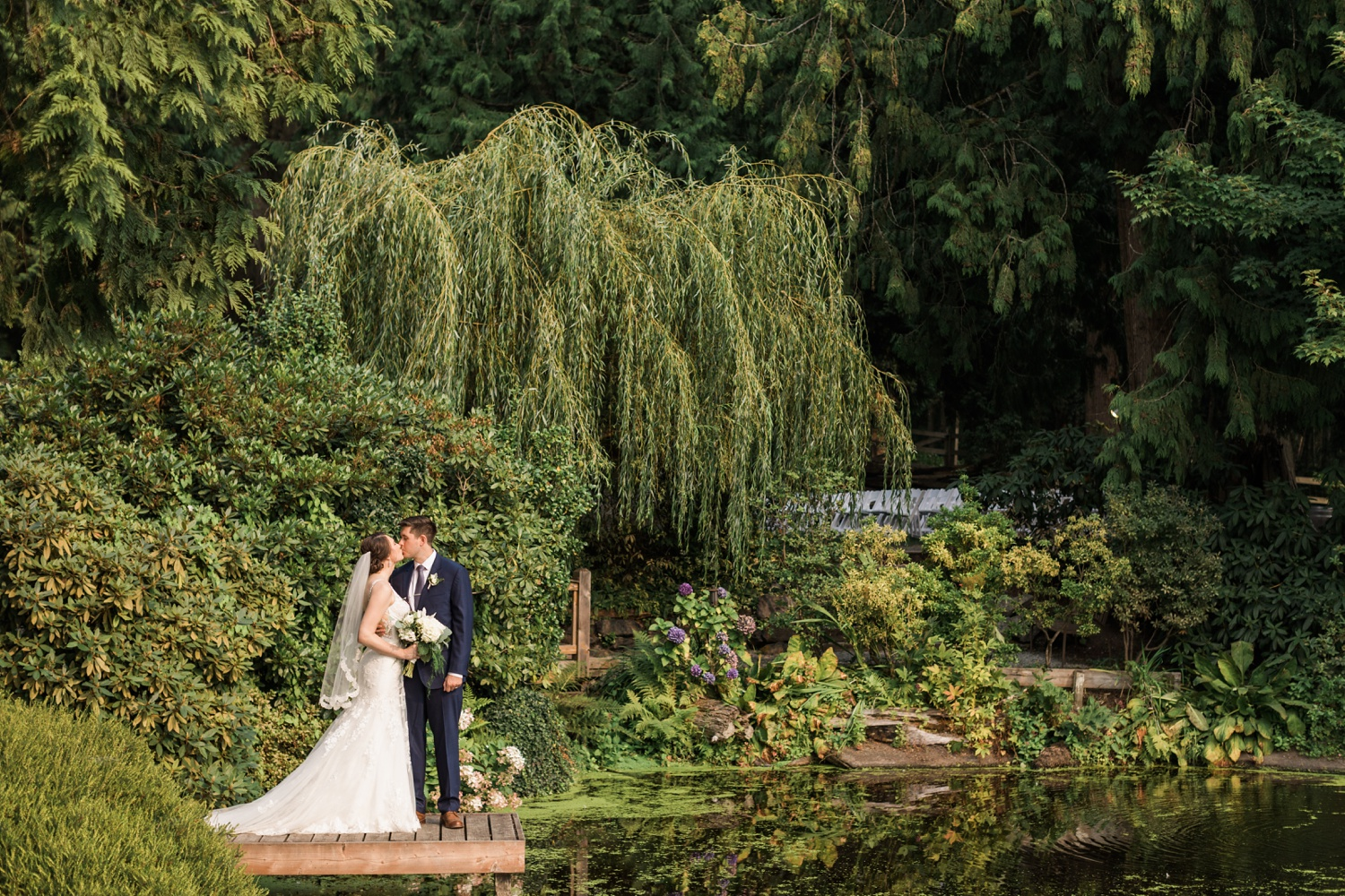 A bride and groom kiss in a beautiful garden before their wedding at Chateau Lill in Woodinville, a wedding venue near Seattle, WA.   Joanna Monger Photography   Seattle & Snohomish Photographer
